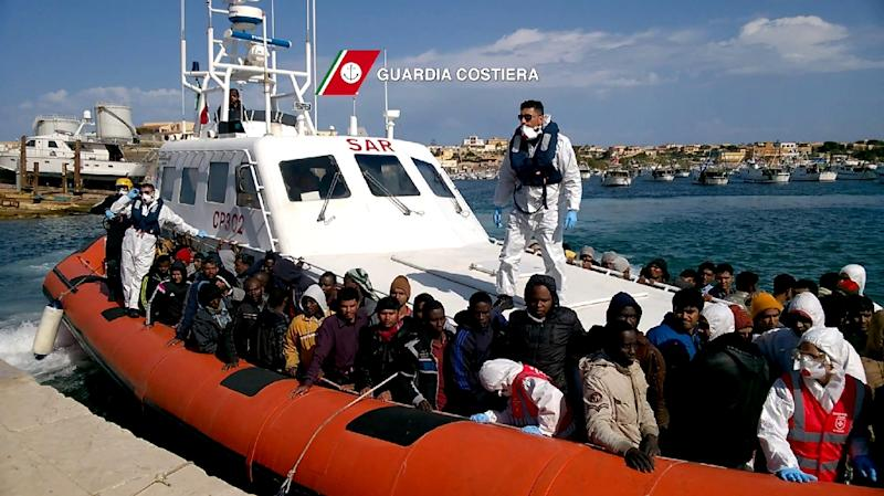 Migrants arrive in the port of Lampedusa on a boat of the Guardia Costiera following a rescue operation off the coast of Sicily, on April 5, 2015