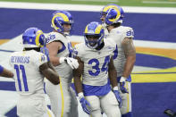Los Angeles Rams running back Malcolm Brown (34) celebrates his rushing touchdown against the Dallas Cowboys during the first half of an NFL football game Sunday, Sept. 13, 2020, in Inglewood, Calif. (AP Photo/Jae C. Hong)