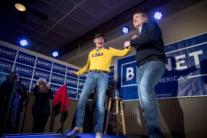 Sen. Michael Bennet, D-Colo., right, embraces James Carville, a political commentator known for leading former President Bill Clinton's 1992 presidential campaign, left, as he speaks at a campaign stop at the Spotlight Room at the Palace, Saturday, Feb. 8, 2020, in Manchester, N.H. (Andrew Harnik/AP)