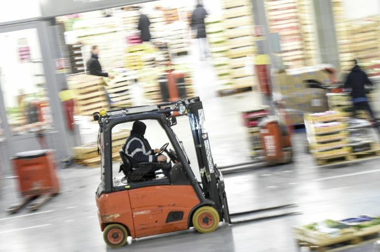 Manually driven forklifts could become a thing of the past, replaced by automated guided vehicles (AFP Photo/Sebastien SALOM-GOMIS)