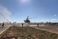 Iraqi army commanders visit by helicopter a military base near a border crossing with Syria at Al-Qaim