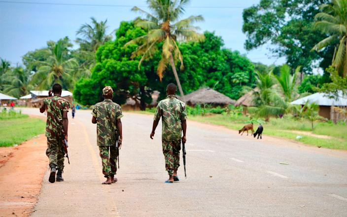 Soldiers from the Mozambican army patrol the streets after security in the area was increased - ADRIEN BARBIER /AFP