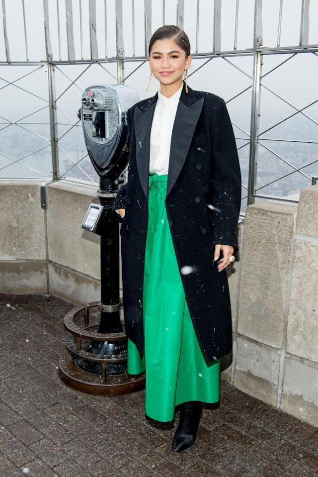 <p>The actress pulled off the perfect winter look in a Ralph Lauren coat, Martin Grant skirt, and Giuseppe Zanotti shoes as she joined her cast to light up the Empire State Building. (Photo: Getty Images) </p>