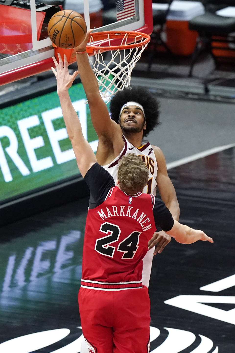 Cleveland Cavaliers center Jarrett Allen, top, blocks a shot by Chicago Bulls forward Lauri Markkanen during the second half of an NBA basketball game in Chicago, Wednesday, March 24, 2021. The Cleveland Cavaliers won 103-94. (AP Photo/Nam Y. Huh)
