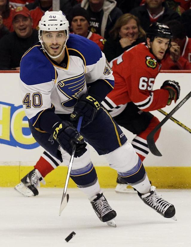 St. Louis Blues' Maxim Lapierre (40) controls the puck against the Chicago Blackhawks during the second period in Game 4 of a first-round NHL hockey playoff series in Chicago, Wednesday, April 23, 2014. (AP Photo/Nam Y. Huh)