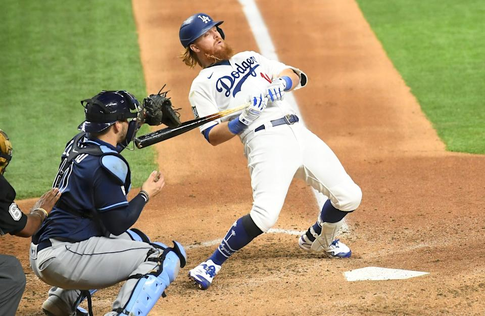 Justin Turner avoids a pitch in front of Rays catcher Mike Zunino