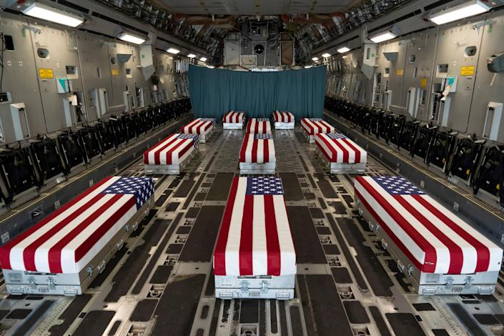 Flag-draped transfer cases of U.S. military service members who were killed by an August 26 suicide bombing at Kabul's Hamid Karzai International Airport line the inside of a C-17 Globemaster II prior to a dignified transfer at Dover Air Force Base, Delaware, U.S., August 29, 2021.   U.S. Marines/Handout via REUTERS THIS IMAGE HAS BEEN SUPPLIED BY A THIRD PARTY.