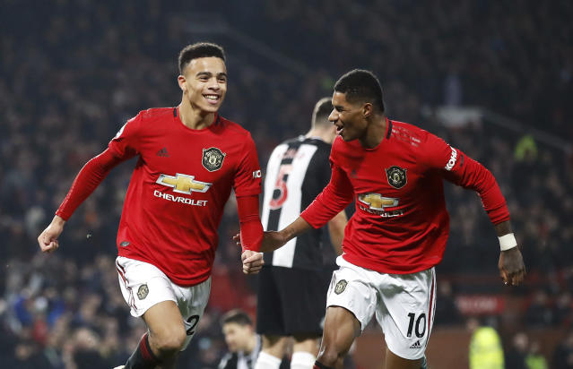 Manchester United's Mason Greenwood (left) celebrates scoring his side's second goal against Newcastle United at Old Trafford. (Martin Rickett/PA via AP)