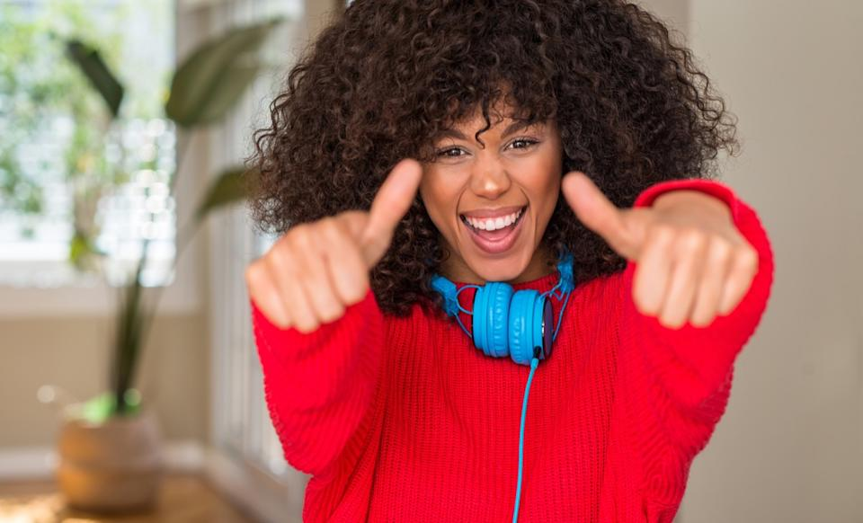 woman smiling with her thumbs up
