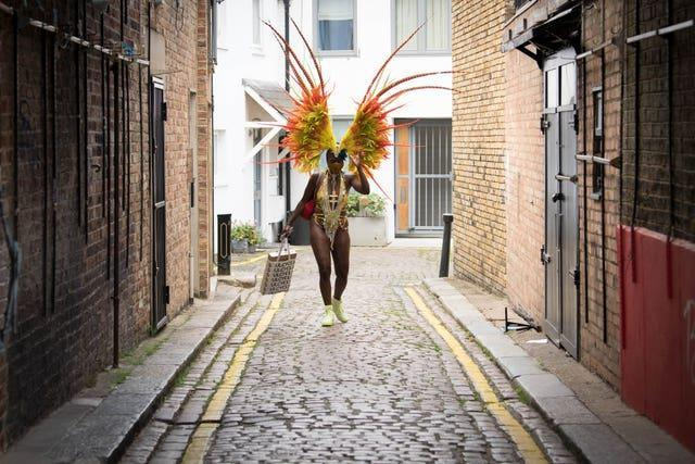 A woman in costume heading to take part in the online Notting Hill Carnival, north London, after the 2020 carnival was cancelled (Stefan Rousseau/PA)