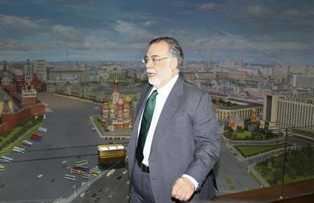 "Film director Francis Ford Coppola walks to take part in a photocall dedicated to the premiere of his movie ""Twixt"", in front of a panorama of the Russian capital at Ukraine Hotel, also known as the ""Ukraina Hotel"", in Moscow, April 4, 2012. REUTERS/Ivan Burnyashev/Files"