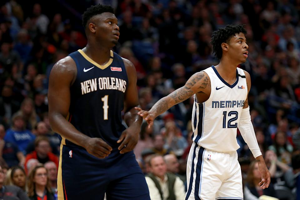 Ja Morant (right) is the Rookie of the Year favorite, but Zion Williamson could still grab bragging rights. (Sean Gardner/Getty Images)
