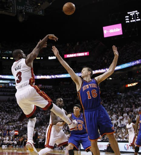 Miami Heat's Dwyane Wade (3) shoots past New York Knicks' Steve Novak (16) in the first half during an NBA basketball game in the first round of the Eastern Conference playoffs in Miami, Saturday, April 28, 2012. (AP Photo/Lynne Sladky)