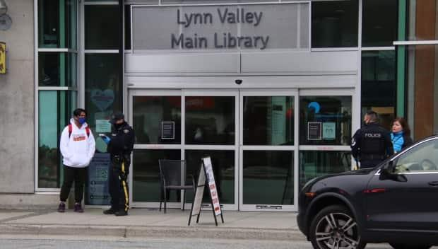 Police interview people in North Vancouver on Saturday after at least six people were stabbed.