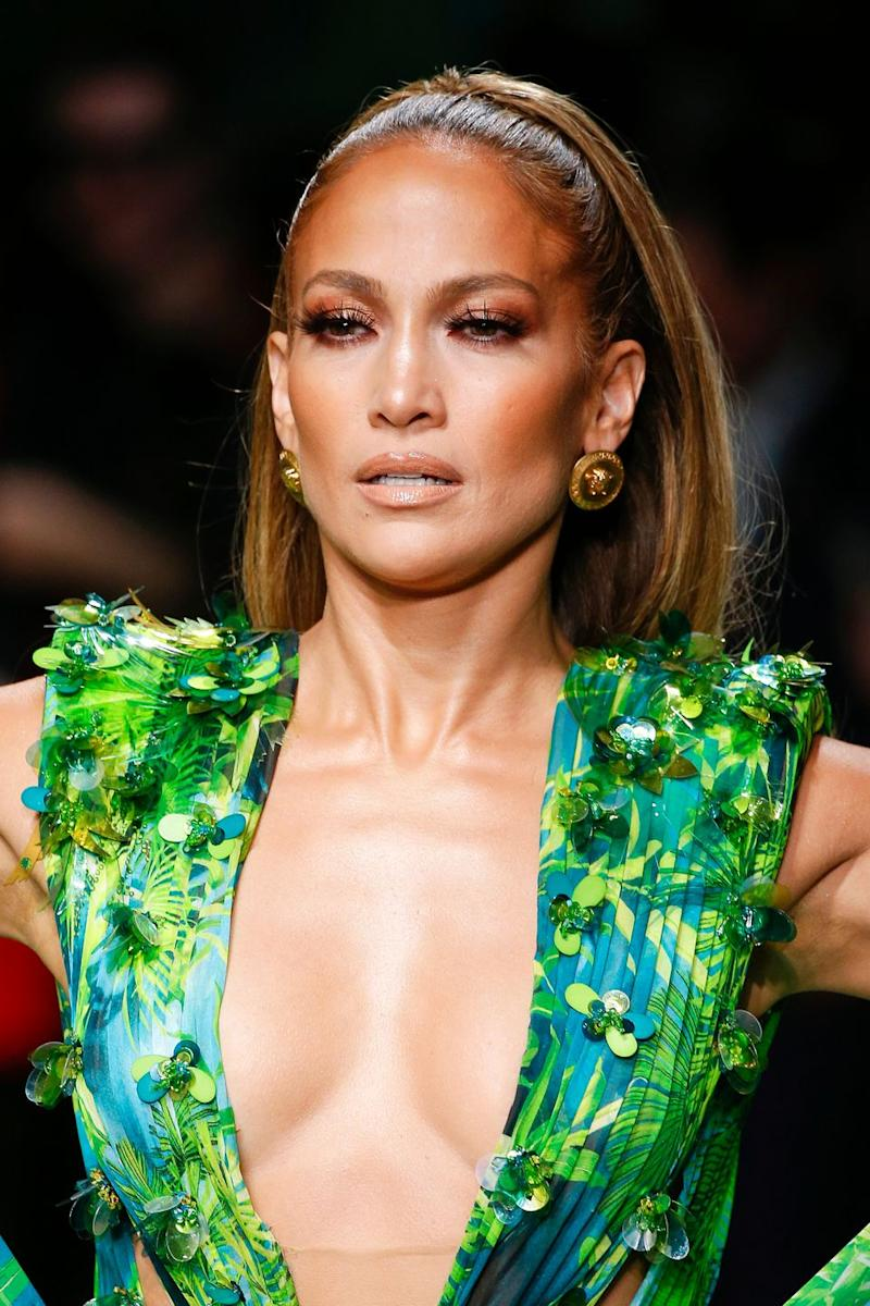MILAN, ITALY – SEPTEMBER 20: Jennifer Lopez at the Versace show during the Milan Fashion Week Spring/Summer 2020 on September 20, 2019 in Milan, Italy. (Photo by Estrop/Getty Images)