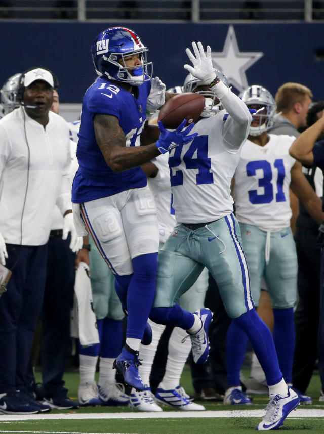 New York Giants wide receiver Cody Latimer (12) catches a pass in front of Dallas Cowboys cornerback Chidobe Awuzie (24) in the second half of a NFL football game in Arlington, Texas, Sunday, Sept. 8, 2019. (AP Photo/Michael Ainsworth)
