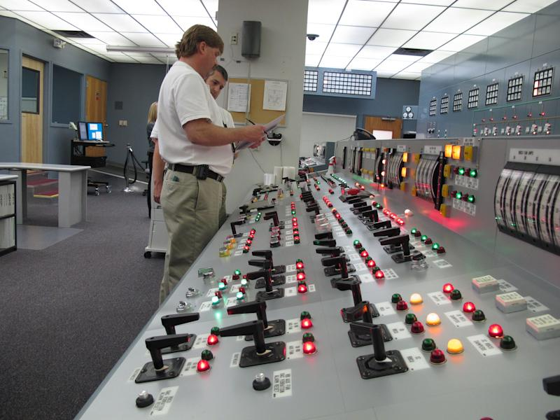 In this March 30, 2011 photo, nuclear reactor operators Chris Heniz, left, and Roger Patterson respond to an emergency scenario on a simulator of a digital control panel at Oconee Nuclear Station in Seneca, S.C. The nuclear plant will be the first in the U.S. to install an all-digital control panel for one of its reactors. (AP Photo/Jeffrey Collins)