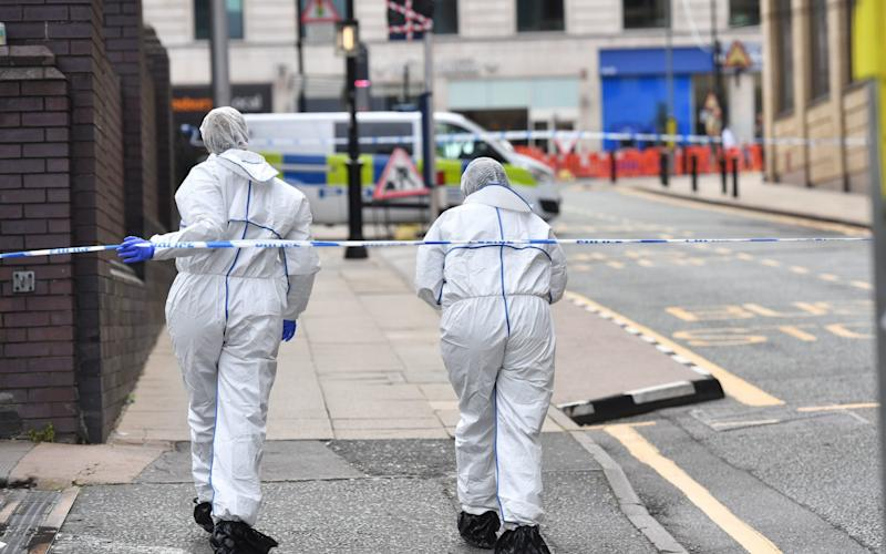 Two police forensics officers enter the cordoned area in Livery Street in Birmingham after a number of people were stabbed in the city centre. -  Jacob King/PA Wire