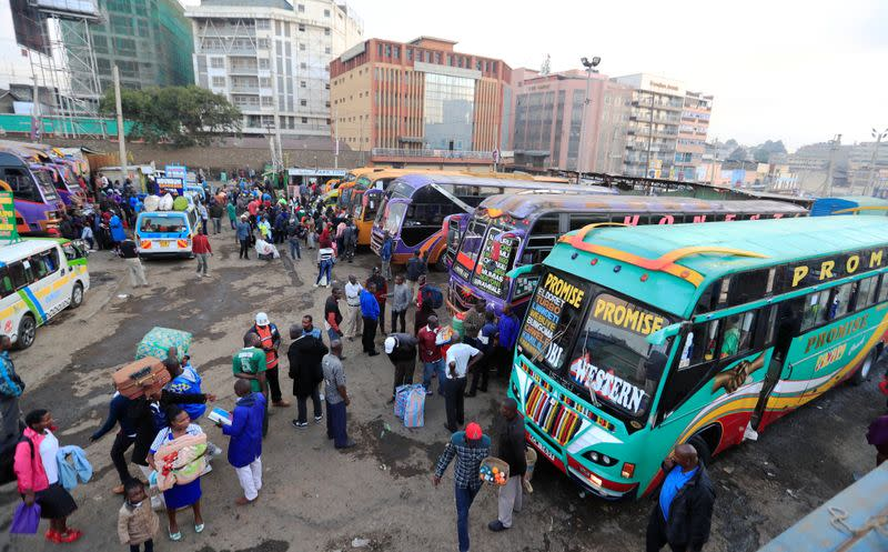 Passengers board a disinfected public transport buses as residents leave for the villages amid concerns over the spread of coronavirus disease (COVID-19) in Nairobi