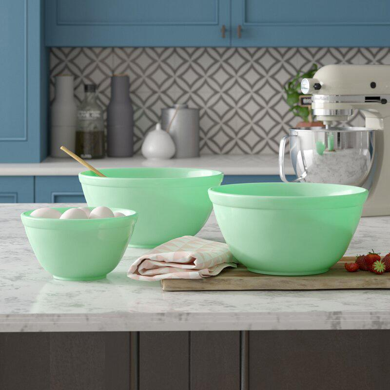 """<p>It's sad to think where we'd be without mixing bowls. Not knee-deep in blueberry muffins, that's for sure. Calories don't count if they're stirred in a cute bowl, right?</p> <p><strong>Buy It: $71.99; <a href=""""http://www.anrdoezrs.net/links/7799179/type/dlg/sid/SLJadeiteIstheRetroKitchenTrendWereLovingRightNowHereAre10FavoriteItemsToShopOnlinekyarborough1271KitGal7861931202008I/https://www.wayfair.com/kitchen-tabletop/pdx/mint-pantry-channing-3-piece-glass-mixing-bowl-set-mntp2980.html"""" rel=""""nofollow noopener"""" target=""""_blank"""" data-ylk=""""slk:wayfair.com"""" class=""""link rapid-noclick-resp"""">wayfair.com</a></strong></p>"""
