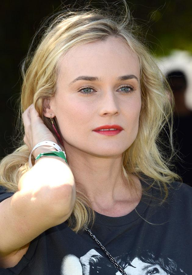 """Celebrities wearing red lipstick: Diane Kruger wore cherry-red lipstick to <a href=""""http://uk.lifestyle.yahoo.com/photos/coachella-festival-2013-diane-kruger-kate-bosworth-and-katy-perry-lead-the-stylish-celebs-slideshow/"""" data-ylk=""""slk:Coachella;outcm:mb_qualified_link;_E:mb_qualified_link;ct:story;"""" class=""""link rapid-noclick-resp yahoo-link"""">Coachella</a>.<br><br>[Getty]"""