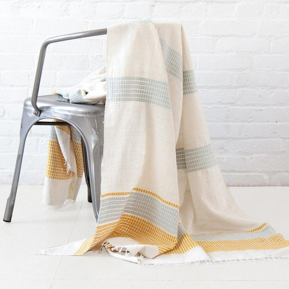 <p>The minimalist look of the <span>Gabi Ethiopian Throw Blanket</span> ($155) will blend with anything, whether it's placed on a couch or an accent chair.</p>