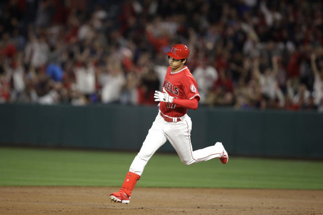 Shohei Ohtani is making noise with his arm and bat right away (AP Photo).