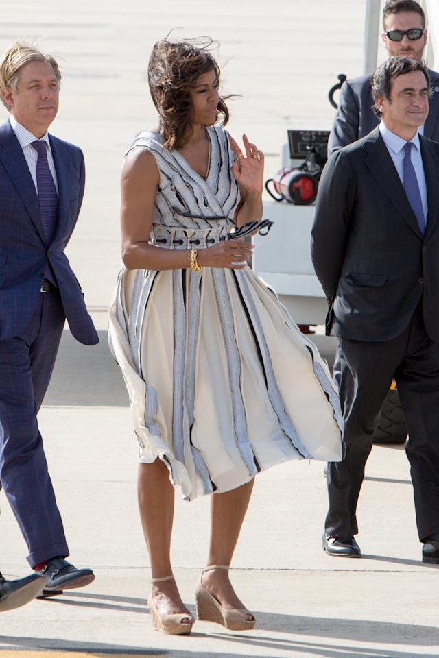 Michelle obama and queen letizia of spain stroll together for Schoolboy q girl power shirt