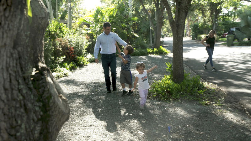 "IMAGE DISTRIBUTED FOR WORLD SATELLITE TELEVISION NEWS - Eighteen days after revealing that he tested positive for COVID-19, Miami Mayor Francis Suarez strolls along neighborhood path with daughter Gloriana, son Andrew, and wife Gloria after coming home on Monday, March 30, 2020 in the Coconut Grove neighborhood of Miami. The 44-year-old leader of America's ""Magic City"" was released from quarantine following new test results that show he is no longer infected with the virus. (Bryan Glazer/World Satellite Television News via AP Images)"