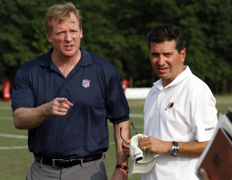 NFL commissioner Roger Goodell, left, talks with Washington Football Team owner Daniel Snyder at training camp in 2010. (AP Photo/Rob Carr, File)