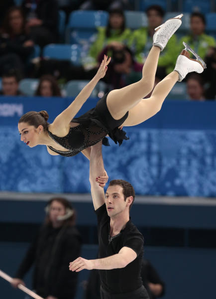 Marissa Castelli and Simon Shnapir of The United States compete in the team pairs short program figure skating competition at the Iceberg Skating Palace during the 2014 Winter Olympics, Thursday, Feb. 6, 2014, in Sochi, Russia. (AP Photo/Ivan Sekretarev)