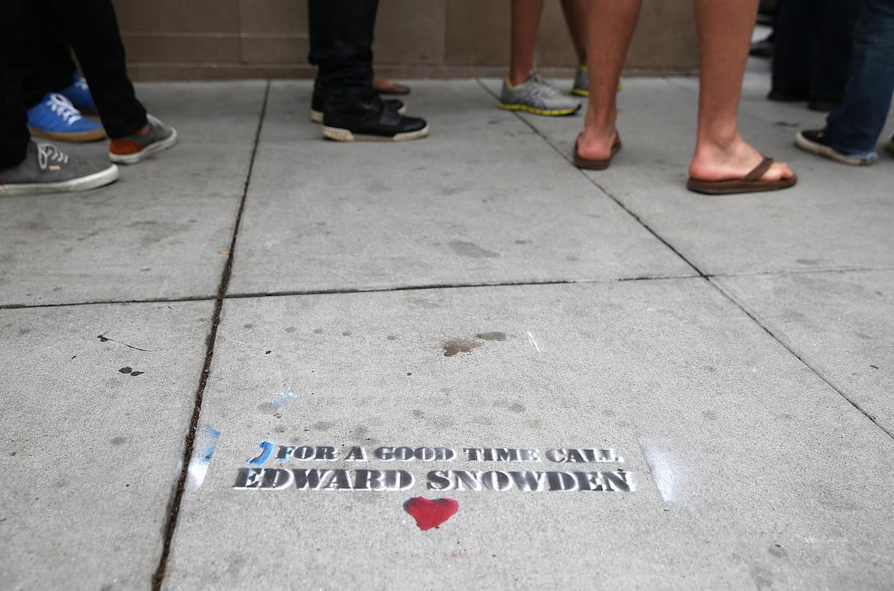SAN FRANCISCO, CA - JUNE 11: Graffiti that is sympathetic to NSA leaker Edward Snowden is seen stenciled on the sidewalk on June 11, 2013 in San Francisco, California. Edward Snowden, 29, a former contractor for the NSA who worked for the consulting firm Booz Allen Hamilton, recently leaked details about previously unknown U.S. surveillance programs. (Photo by Justin Sullivan/Getty Images)