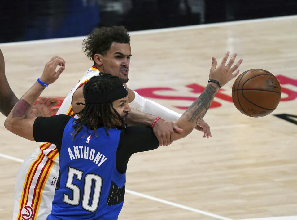 Orlando Magic guard Cole Anthony (50) knocks the ball from Atlanta Hawks guard Trae Young (11) in the second half of an NBA basketball game Thursday, May 13, 2021 in Atlanta. (AP Photo/Tami Chappel)