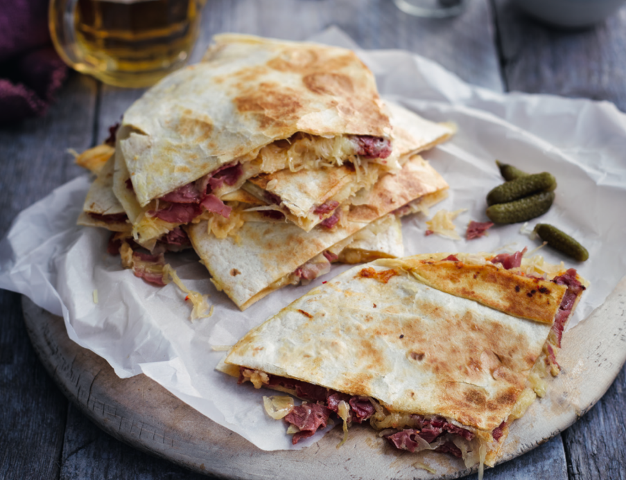 """<p>These beef reuben quesadillas make for a cheesy, speedy and satisfying midweek meal. You can even swap the pastrami for the same quantity of sliced corned beef.</p><p><a class=""""link rapid-noclick-resp"""" href=""""https://www.redonline.co.uk/food/recipes/a32728798/beef-quesadillas-recipe/"""" rel=""""nofollow noopener"""" target=""""_blank"""" data-ylk=""""slk:BEEF REUBEN QUESADILLAS"""">BEEF REUBEN QUESADILLAS</a></p>"""