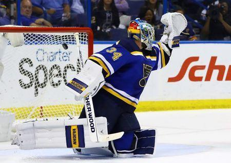 May 23, 2016; St. Louis, MO, USA; St. Louis Blues goalie Jake Allen (34) allows a goal scored by San Jose Sharks center Joe Pavelski (not pictured) in game five of the Western Conference Final of the 2016 Stanley Cup Playoffs at Scottrade Center. Mandatory Credit: Billy Hurst-USA TODAY Sports