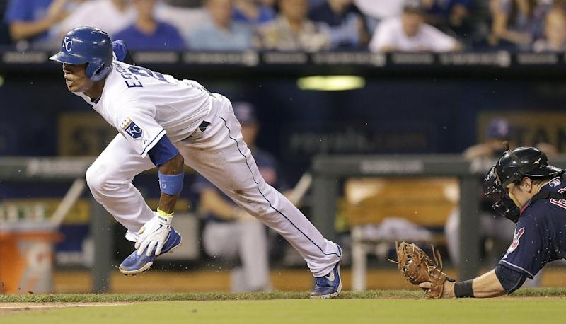 Kansas City Royals' Alcides Escobar gets past Cleveland Indians catcher Yan Gomes to steal home during the fifth inning of a baseball game Wednesday, Sept. 18, 2013, in Kansas City, Mo. (AP Photo/Charlie Riedel)