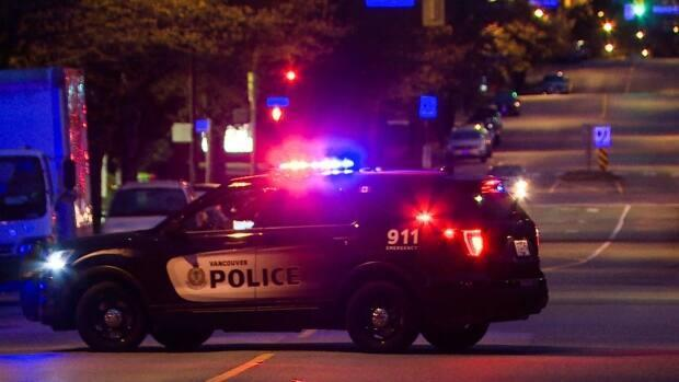 Three Vancouver police officers are facing charges over allegations stemmingfrom arrest of a cyclist who fled after being spotted without helmet, lights and reflectors. (GP Mendoza/CBC - image credit)