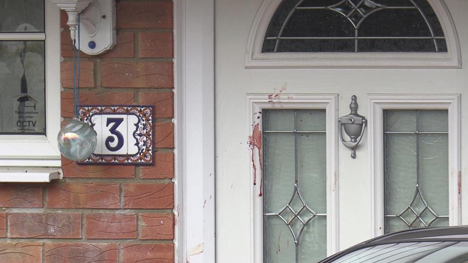 A blood stain on the house door. (PA)