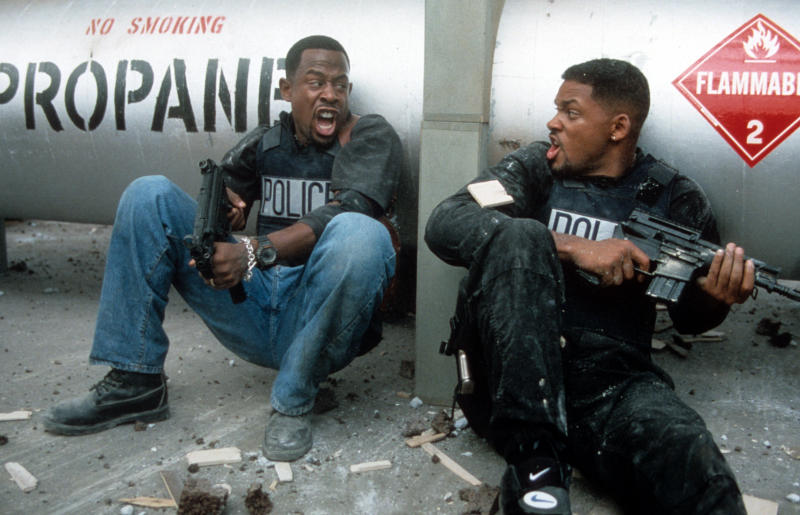 Martin Lawrence and Will Smith yelling at each other while holding machine guns to defend themselves in a scene from the film 'Bad Boys', 1995. (Photo by Columbia Pictures/Getty Images)