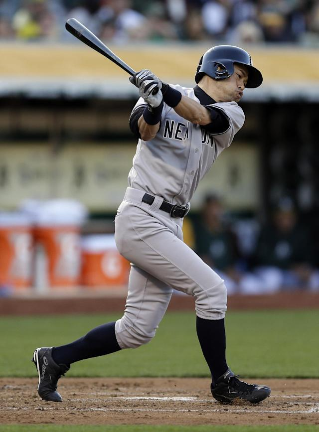 New York Yankees' Ichiro Suzuki, of Japan, strikes out on pitches from Oakland Athletics' Sonny Gray in the second inning of a baseball game on Friday, June 13, 2014, in Oakland, Calif. (AP Photo/Ben Margot)