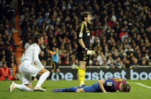 Real Madrid's goalkeeper and captain Iker Casillas (C), Real Madrid's defender Sergio Ramos (L) and Barcelona's midfielder Andres Iniesta (R) react during the Spanish Cup match in January 2012. Casillas and Iniesta said Saturday a potentially damaging rift between the team's Barcelona and Real Madrid players is a thing of the past
