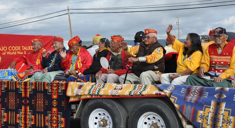 This undated image provided by the Navajo Tourism Department shows a group of Navajo Code Talkers during the 2011 Navajo Nation Fair parade in Window Rock, Ariz. An economic impact study and yearlong survey show spending by tourists on the Navajo Nation has increased by nearly one-third since 2002. (AP Photo/Navajo Tourism Department, Roberta John)