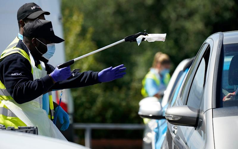A coronavirus test is carried out at a drive-through testing centre in Stone, Staffordshire - Christopher Furlong/Getty Images Europe