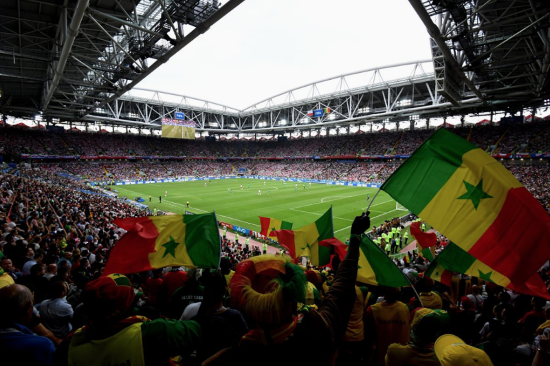 Senegal And Japan Football Fans Celebrate By Helping Clean Up Stadiums After Match