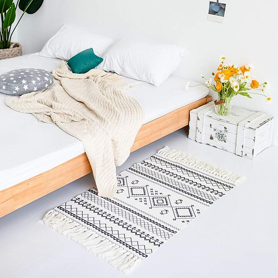 """<a href=""""https://www.amazon.com/dp/B07QGB8LP9"""" rel=""""nofollow noopener"""" target=""""_blank"""" data-ylk=""""slk:Ukeler Printed Boho Bathroom Rug"""" class=""""link rapid-noclick-resp""""><h3>Ukeler Printed Boho Bathroom Rug<br></h3></a><br>This tasseled rug can work in your bathroom, by your bedside, and in the hallway. It's easy to clean (major plus) and adds a subtle decorative touch to smaller spaces.<br><br><strong>Ukeler</strong> Printed Boho Bathroom Rug , $, available at <a href=""""https://www.amazon.com/Ukeler-Bathroom-Decorative-Bohemian-Entryway/dp/B07QGB8LP9/"""" rel=""""nofollow noopener"""" target=""""_blank"""" data-ylk=""""slk:Amazon"""" class=""""link rapid-noclick-resp"""">Amazon</a>"""