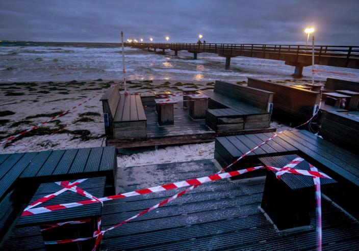A beach bar is closed due to the lockdown at the pier in Scharbeutz, northern Germany, Tuesday, Jan. 5, 2021. German government will discuss further restrictions to avoid the outspread of the Coronavirus. (AP Photo/Michael Probst)