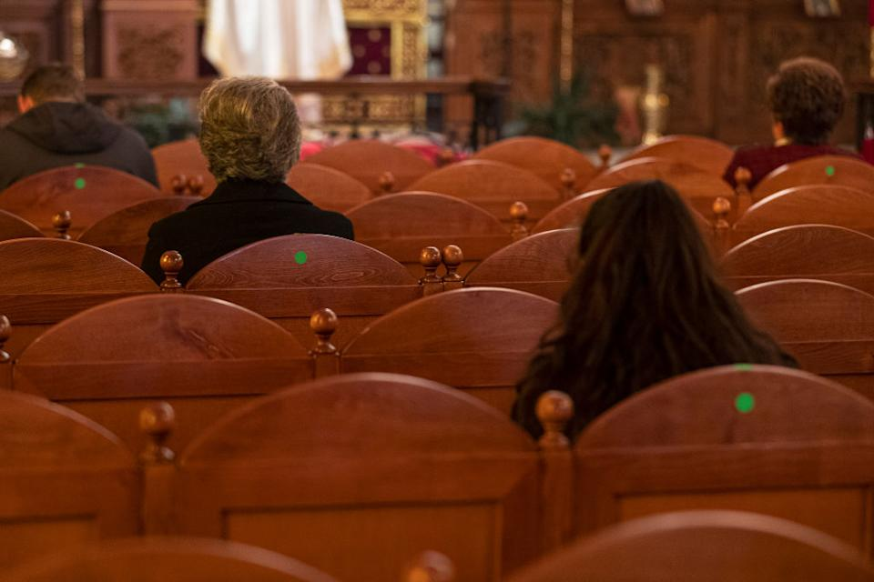 Parishioners physically distance at East Keilor Panagia Soumela on June 7, 2020 in Melbourne.