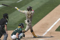San Diego Padres' Fernando Tatis Jr hits a solo home run against the Oakland Athletics during the seventh inning of a baseball game in Oakland, Calif., Sunday, Sept. 6, 2020. (AP Photo/Jed Jacobsohn)