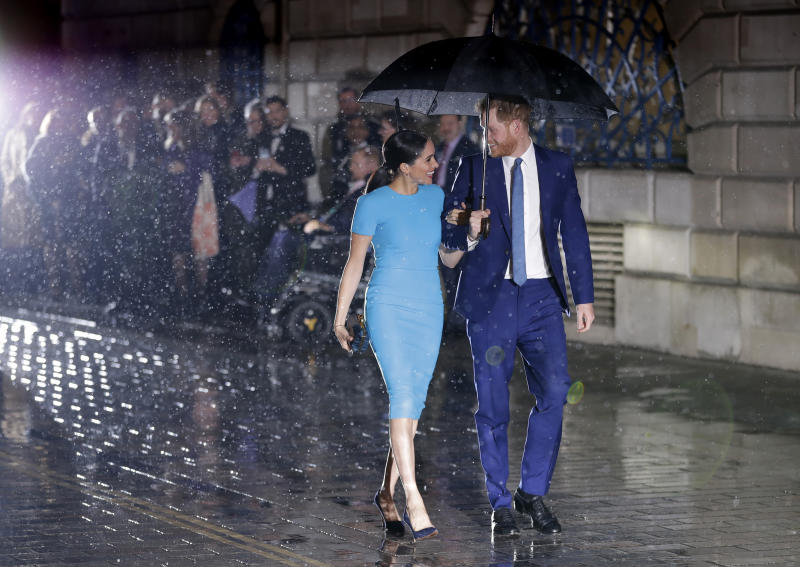 Britain's Prince Harry and Meghan, the Duke and Duchess of Sussex arrive at the annual Endeavour Fund Awards in London, Thursday, March 5, 2020. The awards celebrate the achievements of service personnel who were injured in service and have gone on to use sport as part of their recovery and rehabilitation. (AP Photo/Kirsty Wigglesworth)