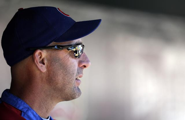 Chicago Cubs manager Dale Sveum stands in the dugout before the start of a baseball game against the St. Louis Cardinals Sunday, Sept. 29, 2013, in St. Louis. (AP Photo/Jeff Roberson)